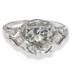 An art deco diamond and platinum ring, circa 1930 central transitional-cut diamond weighing approximately: 1.75 carats; mounted in platinum.