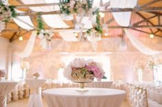 Simple but elegant floral centrepiece in blush gold and ivory created by Akiko Floral Artistry.  Photo Credit:  Milton Photography.  #draping #ceiling #hanging #flowers #wedding #centrepiece #phalaenopsis #orchids #blush #gold #blushandgold #ivory #tulips #roses #peonies #hydrangea