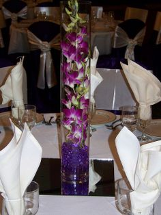 Centrepieces will be similar, except instead of mirror, there will be fabric and lots of candles. And maybe change the purple gel beads to clear.. the purple ones might be overkill since the napkins will also be dark and light purple.