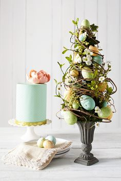 Complement an appetizing Easter buffet table with Pier Blue Speckled Eggs Topiary. Hand-sculpted eggs are woven within a delicate mixture of faux flowers, berries and natural grapevine, all in a classic base. Easter Flower Arrangements, Easter Flowers, Easter Buffet, Easter Table, Easter Eggs, Easter Tree Decorations, Easter Wreaths, Easter Decor, Easter Centerpiece
