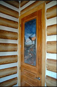 A log cabin inspired room for a little boy.  Door painted to complete the theme. Artwork by Carmen Illustrates.