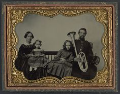 [Unidentified soldier in Union uniform with wife and daughters holding saxhorn] (LOC) by The Library of Congress, via Flickr