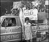 """Students protest busing plan -  percentage of white students in Richmond city schools declined from 45 to 21 percent between 1960  1975. This """"white flight"""" prevented Richmond schools from becoming truly integrated. After voter referendum to combine suburban school districts of Chesterfield  Henrico with city of Richmond's failed, Federal District Judge Robert Mehrige ordered merger by judicial action (busing to achieve racial balance in the schools) 