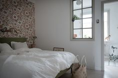 Bedroom with colourful floral wallpaper