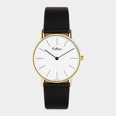 """A timeless minimalist design, the ultra-thin Lines Watch features a large, easy-to-read white dial, curved scratch-resistant sapphire crystal, ultra-thin quartz movement, gold-plated case, and black calf leather strap. Originally designed in 1962, the enduring Lines Watch was awarded """"The Classics Prize"""" in 2004 by the Danish Design Center. Available at MOMA for $1,350."""