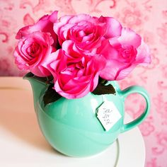 Use a teapot as a vessel for a valentine gift such as flowers or other goodies. make a small tea bag shape out of cardstock and string