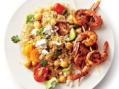 Spicy Grilled Shrimp with Quinoa Salad | Quinoa, shrimp, and chickpeas pack a triple punch of protein in the this tasty summer dish of Spicy Grilled Shrimp with Quinoa Salad.