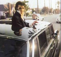 Elvis standing through the open sunroof of a '69 Mercedes 600 limousine