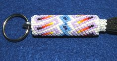 Love authentic Native American beadwork?  Then check out this keyring! Quality peyote stitch style beadwork on a leather wrapped wooden dowel. Tightly sewn. 35.00 w/ free shipping. Great gift idea! New. #beadwork #nativeamerican