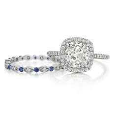 18K White Gold Pavé Halo Engagement Ring with Cushion Cut Diamond and Matching Diamond and Blue Sapphire Milgrain Details Eternity Band
