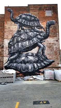 Richmond, VA - Street Art & Graffiti.  There is an unexpected cache of beautiful murals in Richmond.  This one from the artist ROA #roagraffiti from the 2012 Richmond Mural fest - Apparently there are 60-100 murals in the city and I look forward to hunting them down.  Original Photography by R. Stowe.
