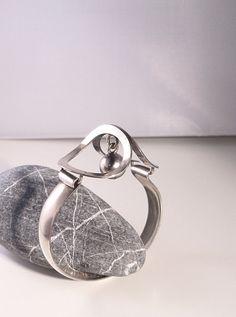 Erik Granit (FI), modernist sterling silver vintage bracelet with a dangling silver sphere detail, 1970s. #finland   finlandjewelry.com