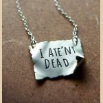 'I ATE'NT DEAD' Necklace  Existentialism at its best, courtesy of Granny Weatherwax. Give me this now.