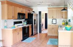 beautiful kitchen using molding to update and add height to cabinets quickly and without painting