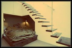 Alcove bed under stairs.