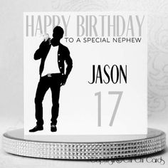 A stylish square birthday card featuring a man taking a photo on his mobile phone. He is dressed in a black shirt with white T-shirt, black trousers and shoes. The man has 4 clear Swarovski crystals as buttons on his shirt, one on his belt and another on the phone for the camera flash.  #Smartphone #Phone #MobilePhone #CellPhone #Style #Trend #Luxury #BirthdayCard #MaleBirthday #Style #Retro #Birthday #PersonalisedCards #CardMaking #HandmadeCards #Cards #GreetingCards Luxury Birthday Cards, Birthday Cards For Men, Special Birthday, Retro Birthday, Man Birthday, Personalized Birthday Cards, Handmade Birthday Cards, Work Colleague, Luxury Card
