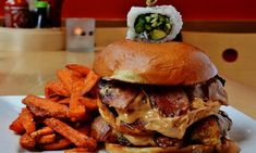 10 Outrageously Good Burgers Across America  From peanut butter to pork belly, adventurous burger connoisseurs pull out all the topping stops.