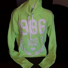 Victoria's Secret Pink,Cropped,Hoodie White Graphics Glow in the dark green. Hoodie Xsmall Bought Nwot,from dealer,spot on label to keep from returning to store. Kangaroo Pockets Tried on once/preowned for that reason only. Victoria's Secret Tops Sweatshirts & Hoodies