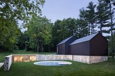 an extension to philip johnson's wiley house, the grounds now include a reconstructed barn for an art gallery and pool house within historic stone walls.
