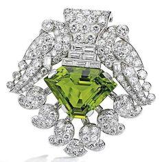Platinum, peridot and diamond brooch by @Cartier circa 1930