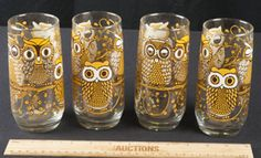 COOL SET OF 4 DRINKING GLASSES/TUMBLERS IN AN OWL MOTIF. THESE ARE FROM THE 1970S.