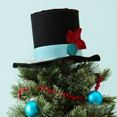 cute christmas tree topper -- top hat with poinsettia and ribbons Funny Christmas Tree Toppers, Pretty Christmas Trees, All Things Christmas, Christmas Tree Decorations, Christmas Holidays, Christmas Wreaths, Christmas Ornaments, Snowman Ornaments, Holiday Tree