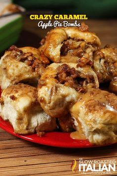 Crazy Caramel Apple Pie Bombs are the pull apart bread of your dreams. This fabulous recipe is packed with caramel and apples and baked to perfection. Pull one open and a river of sweet caramel runs over the apple pie bombs.