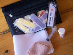 This is an idea for a kiddie play doctor kit, but it's not a bad idea for a travel first aid kit.  You might add different items, same concept.