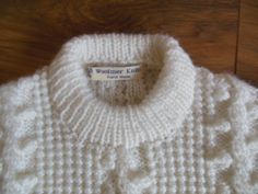 "Fabulous design in aran, 20% wool and 80% acrylic. Lovely and soft and so white. Such a great jumper for the winter months and christmas, of course. Just beautiful. Please check size carefully.  This jumper is to fit a 24"" chest. Chest: 26"" Length: 15.5"" Underarm sleeve seem: 9.75"" Machine ..."