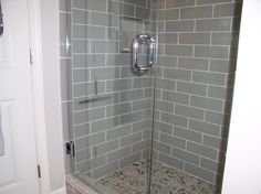 "Smoke Glass 4"" x 12"" Shower Walls with our sliced pebble tile on the shower floor. https://www.subwaytileoutlet.com/products/Smoke-Glass-4x12-Subway-Tile#.VW4OivlViko"