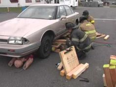 Firefighters demonstrate a single point lift to raise a vehicle. Firefighter Tools, Firefighter Workout, Firefighter Training, Fire Training, Fire Fighters, Metal Detecting, Disaster Preparedness, Fire Dept, Firefighting
