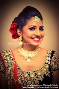 Arpitha looks like a diva for her reception in a dramatic makeup and bridal lehenga. Makeup and hairstyle by Vejetha for Swank Studio. Photo credit: Manish Ananda. Red lips. Eye makeup. Bridal lehenga. Bridal jewelry. Bridal hair. Indian Bridal Makeup. Indian Bride. Gold Jewellery. Tamil bride. Telugu bride. Kannada bride. Hindu bride. Malayalee bride. Find us at https://www.facebook.com/SwankStudioBangalore