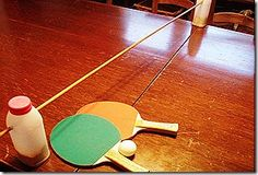 Ping Pong Table DIY: Make it with two juice containers and a wood dowel!