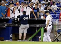 New sultan of swat: Stanton's year won't be forgotten  -  October 2, 2017:     Fans wear T-shirts painted with MVP as Miami Marlins' Giancarlo Stanton (27) walks into the dugout before a baseball game against the Atlanta Braves, Sunday, Oct. 1, 2017, in Miami. (AP Photo/Lynne Sladky)