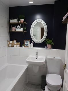 White bathroom suite and white tiles from Wickes to keep things simple and neutral. Added colour and character with a dark navy wall which also gave the small bathroom depth. Then added pink and wood accessories Navy Bathroom, Neutral Bathroom, Bathroom Colors, Small Bathroom, Bathroom Designs, Bathroom Ideas, Pink Toilet, Small Toilet Room, Navy Walls