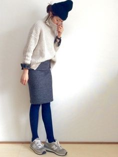 Outfit that shows off both sweater and sneakers.