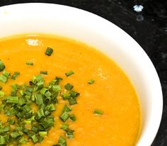 #Butternut_Squash Soup.  Ingredients for 4 servings:      1/2 medium onion, chopped     1/4 cup shallots, minced     1 cup carrots, grated     3 cups butternut squash, seeded, peeled, and cut into 1-inch pieces     1 tablespoon butter     1/2 bay leaf (remove prior to serving)     1/2 teaspoon curry powder     Water (as needed for thinning soup)     2 cups organic low-salt chicken broth     1/4 cup sour cream     1/4 cup chopped green onions