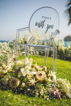 modern clear wedding ceremony chairs with vinyl lettering