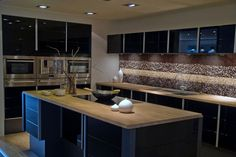 Modern Kitchen Design - solid colours & matte wood with glass & stainless
