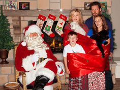"""Kelly Clarkson is going for a decidedly different vibe for her family's first Christmas card.  """"Merry Christmas from the Blackstocks,"""" Cla..."""