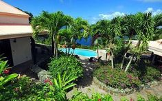 Canefield is set high above Brewers Bay in 10 acres of old sugar plantation grounds dating back to 17th century. This private villa is surrounded with glorious flowering gardens in a park like setting.