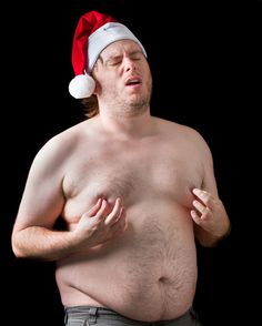 Fat Santa pinching his nipples:   50 Completely Unexplainable Stock Photos No One Will Ever Use