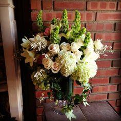Green/White Hydrangeas, White Roses, Bells of Ireland, and White Oriental Lilies.