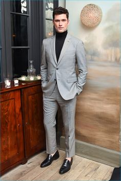 American model Sean O'Pry cleans up in a light grey suit with a black turtleneck by Salvatore Ferragamo.