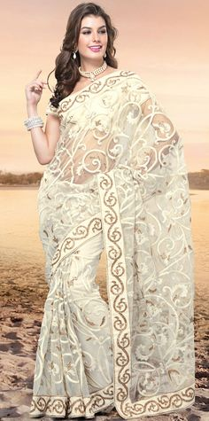 The most beautiful refinements for style and tradition.   This off white net saree is nicely designed with embroidered patch work is done with resham, zari, sequins and stone work.   Beautiful embroidery work on saree make attractive to impress all.   This saree gives you a modern and different look in fabulous style.   Matching blouse is available.   Slight color variations are possible due to differing screen and photograph resolution.