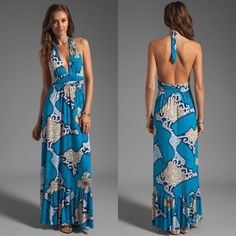"T-Bags Los Angeles Blue Print Halter Maxi Dress T-Bags Los Angeles halter maxi dress. Nautical print in turquoise, aqua blue, navy, goldenrod and white. Size small. Like new. No flaws. 96% poly, 4% spandex. Soft & stretchy. Drapes beautifully over your curves. Approx 56"" long from shoulder seam to hem. Ties around neck. Plunging neckline. You CAN wear a low-front halter bra w/this dress! Stock photos courtesy of T-Bags. Location free home. No trades. Offers welcome! T-Bags Dresses Maxi"