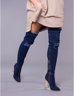 The GIMME MORE distressed denim thigh high heeled boots are made from high quality stretch denim and features a gold block heel. ○ Distressed stretch denim style boots○ Heel height: 4 inches○ Thigh high heeled boot with side zip fastening○ Gold block heel○ True to size