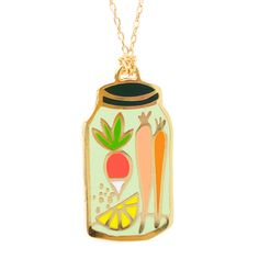 Cloisonne Pendant, gilded in 22 karat gold. 18 karat gold-dipped chain, 30 inch/ 76 cm, approx 1 in diameter. Comes packaged in a unique glass vial with cork.