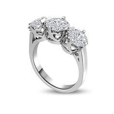 ANELLO TRILOGY CON DIAMANTI 18CT ORO BIANCO | Anello Trilogy con Diamanti Taglio Brillante incastonati in castoni con design a cuore. Il totale dei carati per questo anello e` disponibile da 0.30ct a 0.90ct montati a griffe. Il peso dei carati per ogni diamante varia da 0.10ct a 0.30ct. Tutti i diamanti sono disponibili in H, G ed F colore e in VS1 ed SI1 purezza. L`anello e` accompagnato dal certificato del diamante.