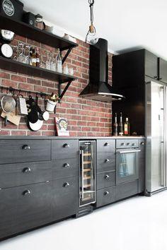 red brick backsplash + black cabinet